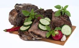 Brot und Fleisch auf dem Hintergrund Stockbild