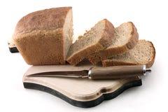 Brot und Messer Stockfoto