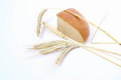 Brot und Stiele des Weizens Stockfotos