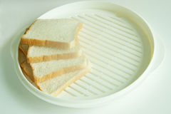 Brot vier auf Platte lizenzfreies stockbild