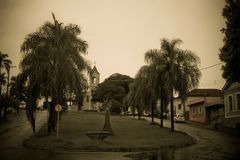 The chapel square. In the small square there is a drinking fountain for animals. in the background the small chapel of the city of Brotas SP Brazil stock image