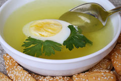 Broth. Appetizing chicken broth in a white plate and bread Royalty Free Stock Images