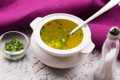 Broth in bowl Stock Photography
