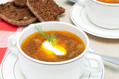 Broth and bread Stock Images