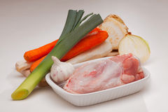 Broth or bullion ingredients. Meat, leek, carrot, parsley rot, onion, garlic and celeriac Royalty Free Stock Photography