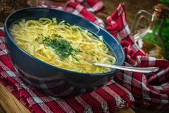 Broth - chicken soup in a bowl. Broth - chicken soup with noodles in a bowl Stock Image