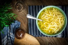 Broth - chicken soup in a bowl. Broth - chicken soup with noodles in a bowl Royalty Free Stock Photo