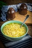 Broth - chicken soup in a bowl. Broth - chicken soup with noodles in a bowl Stock Photo