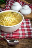 Broth - chicken soup in a bowl. Broth - chicken soup with noodles in a bowl Royalty Free Stock Photos