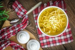 Broth - chicken soup in a bowl. Broth - chicken soup with noodles in a bowl Royalty Free Stock Image