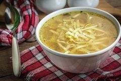 Broth - chicken soup in a bowl. Stock Photo