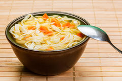 Broth - chicken soup with noodles Stock Photos