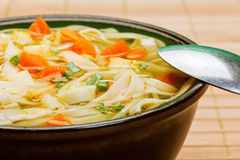 Broth - chicken soup with noodles Royalty Free Stock Photography