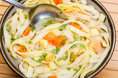 Broth - chicken soup with noodles Royalty Free Stock Image