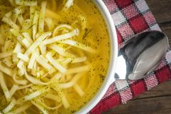 Broth - chicken soup in a bowl. Broth - chicken soup with noodles in a bowl Stock Photos