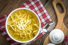 Broth - chicken soup in a bowl. Broth - chicken soup with noodles in a bowl Stock Photography