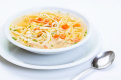 Broth - chicken soup with noodles Royalty Free Stock Photos