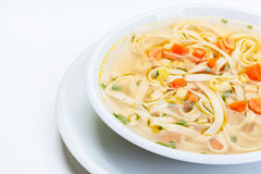 Broth - chicken soup with noodles Stock Images