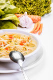 Broth - chicken soup with noodles Stock Image