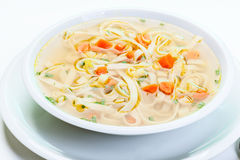 Broth - chicken soup with noodles Royalty Free Stock Images