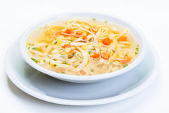 Broth - chicken soup with noodles. On a plate Stock Images