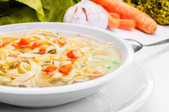 Broth - chicken soup with noodles Stock Photography