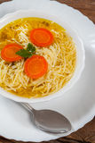 Broth - chicken soup with noodles. Royalty Free Stock Photography