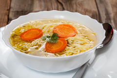 Broth - chicken soup with noodles. Royalty Free Stock Photo