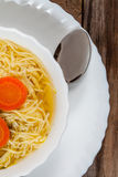 Broth - chicken soup with noodles. Royalty Free Stock Photos