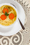 Broth - chicken soup with noodles. Stock Image