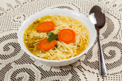 Broth - chicken soup with noodles. Stock Photos