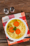 Broth - chicken soup with noodles. Stock Images