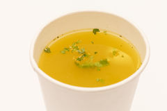 Broth in cup Royalty Free Stock Photography