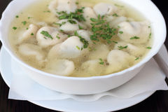 Broth with dumplings. Royalty Free Stock Photography