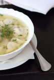 Broth with dumplings. Royalty Free Stock Image