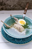 Broth with quail,  egg and greens Royalty Free Stock Photos
