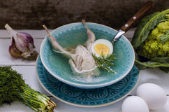 Broth with quail, egg and greens Royalty Free Stock Photo