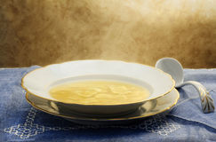 Broth with ravioli Stock Images