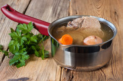 Broth with vegetables Stock Images