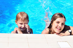 Brothe and sister in the pool Stock Image