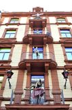 Brothel hotel facade. Facade of the  brothel in Frankfurt city with naked mannequin on the balcony Stock Photo