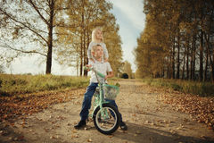 Free Brother And Sister At Autumn Road Royalty Free Stock Photography - 63871977