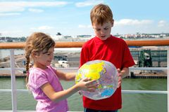 Free Brother And Sister Hold Inflatable Globe Stock Photography - 26281322