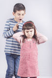 Brother arguing with his little sister. Family relationships concept stock image