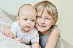 Brother and baby sister stock image