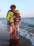 Brother boys on the sea shore Royalty Free Stock Image