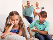 Brother calms angry sister Royalty Free Stock Image