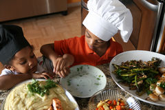 Brother Chefs royalty free stock photography