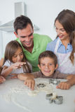 Brother with flour on the nose baking with his family Stock Images