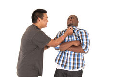 Brother grabs his brother by shirt collar Stock Images